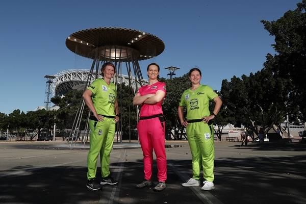 Players from WBBL in front of Olympic Cauldron