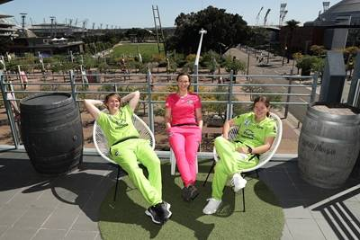 Players from WBBL on Novotel balcony