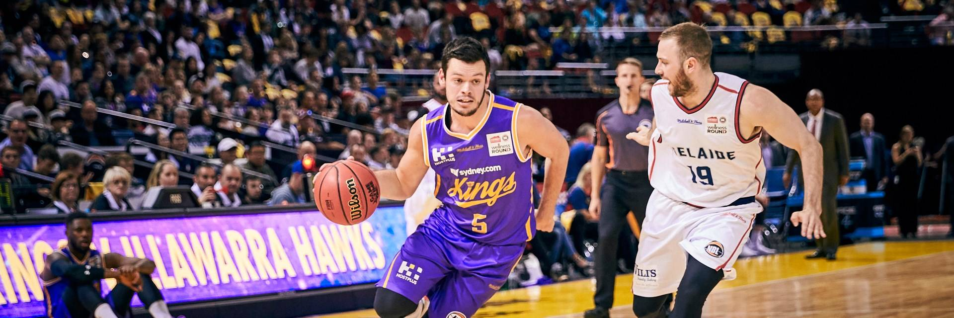 Sydney Kings basketball player facing opponent at Qudos Bank Arena