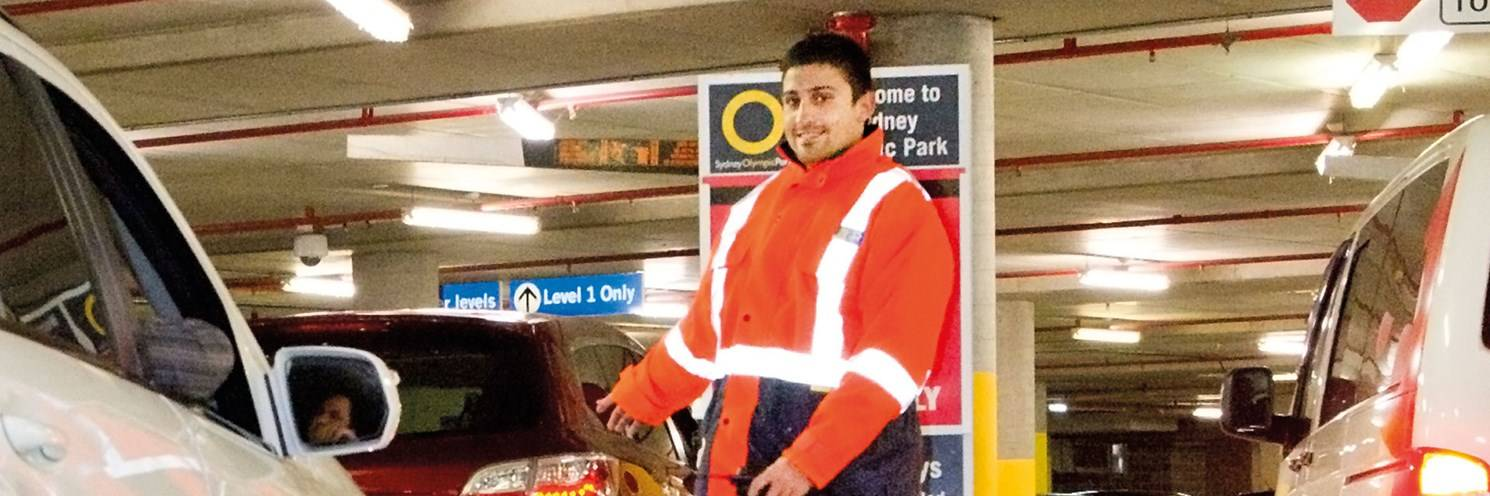 Car park attendant helping customers at Sydney Olympic Park Photo by Paul K Robbins