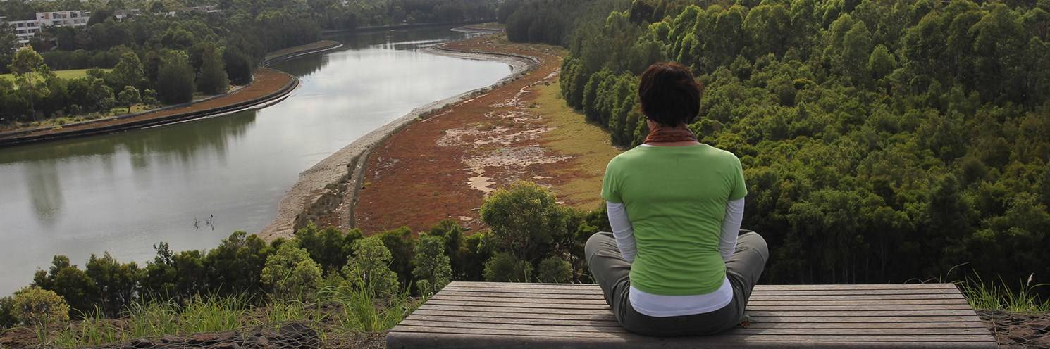 Haslams Creek - Woman at River Marker overlooking Haslams Creek - Photo by Sydney Olympic Park Authority